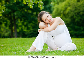 Beautiful pregnant woman in the park - Beautiful pregnant...