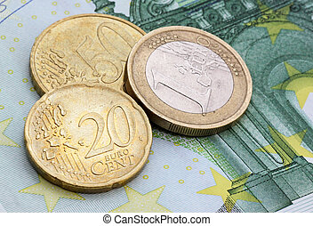 eurocents on one hundred euro banknote - close up of...
