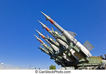 Antiaircraft rockets on the launcher against blue sky