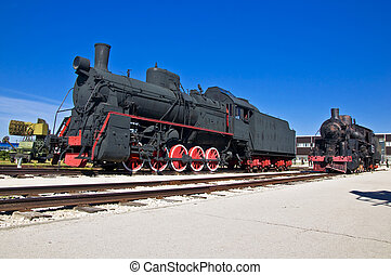 Old steam locomotive at the depot. Museum of Technology in...