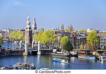 Classical Amsterdam view. Boat floats on the channel on the...
