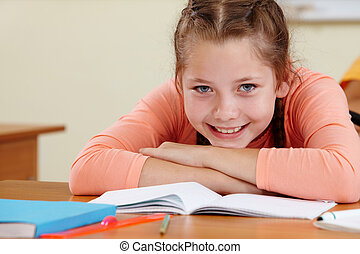 Youthful reader - Portrait of lovely girl with her copybook...