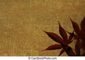 Old paper with red leaves