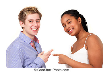 People pointing laughing - Two young people of diverse races...
