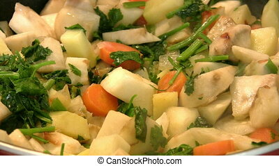 Mixed vegetables boiling in a saucepan