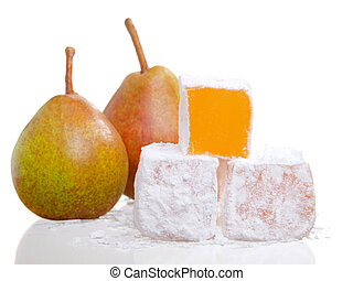 isolated close up of a stack of turkish delight with two pear