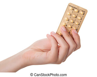tablets (Birth Control Pills) in the hand, isolated on white...