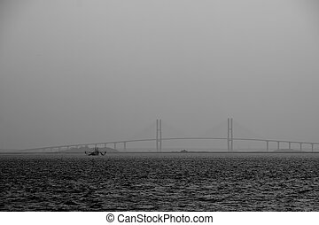 Shrimp Boat by Bridge in Dusk Black and White - A shrimp...