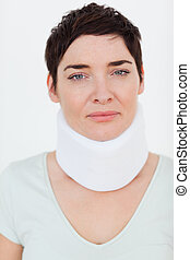 Close up of a Injured Woman with a surgical collar in a...