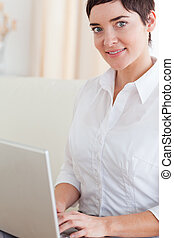 Close up of a woman with a laptop