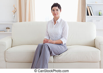 Woman sitting on a sofa in a living room