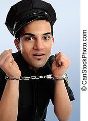 Policeman with handcuffs - Crazy policeman with hands in...