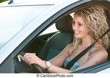 Portrait of young smiling person driving car