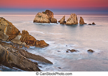 Amazing seascape sunrise at winter Los Urros, Spain