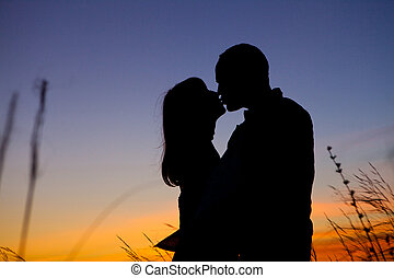 Couple on the sunset background - Pretty couple in the...