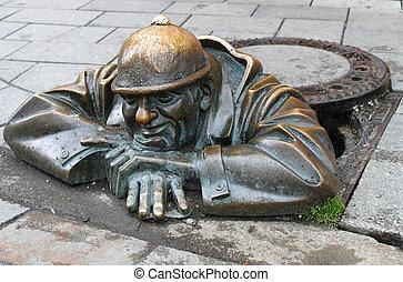 Man at work sculpture - Bronze sculpture of man at work in...