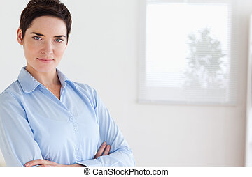 Serious brunette businesswoman posing in an office