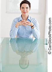 Businesswoman sitting behind a desk