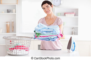 Beautiful Woman with a pile of clothes