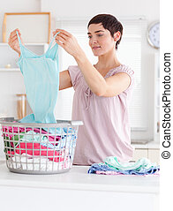 Cute Woman folding clothes