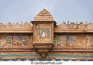 Extensive stone carving in combination with colorful tiles...