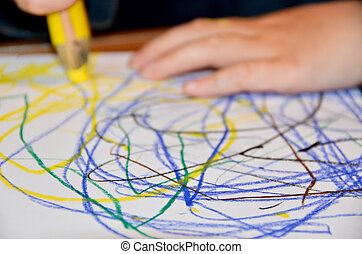Closeup of a child drawing on paper
