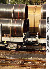 Cargo train - details of cargo train wagons with pipes on...