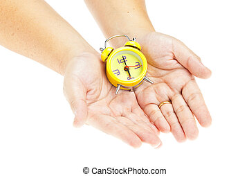 Clock on hand as time management concept