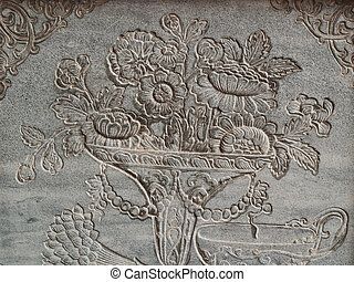 ancient flower engrave on wall