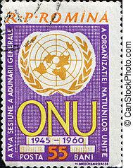 UN emblem - ROMANIA - CIRCA 1960: A stamp printed in Romania...