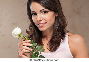 Portrait of woman holding roses - Close-up portrait of...