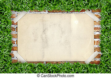Old poster in green grass frame