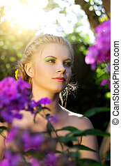 girl in the garden. Flowers - Purple phlox