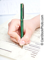 hand with pen over document