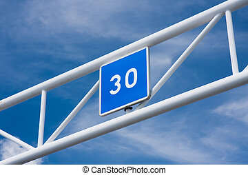 Thirty - A blue sign showing the number 30