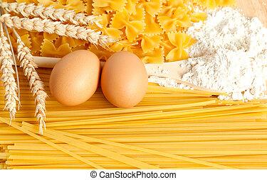 Food background: macaroni, spagetti, egg, flour, wheat