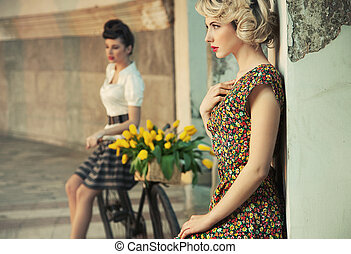 Fashion style photo of a gorgeous women wearing retro...