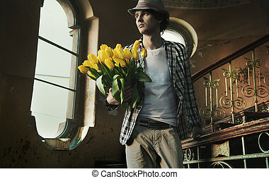 Romantic man holding bunch of tulips