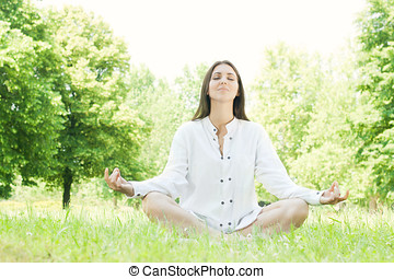 yoga woman - Beautiful young woman doing yoga in nature