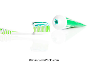 Macro shot of toothbrush with dental paste.