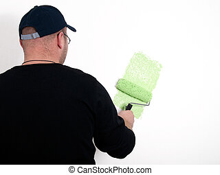 man painter a wall with paint roller