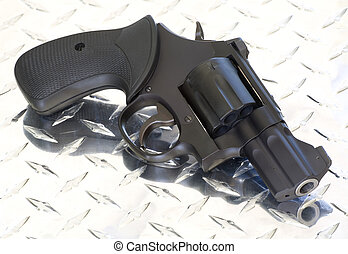 black revolver - handgun that is a revolver with a snub nose...