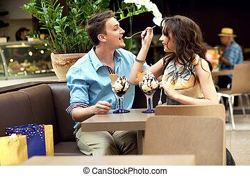 young couple enjoying ice cream