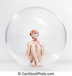 Naked smiling woman in soap ball