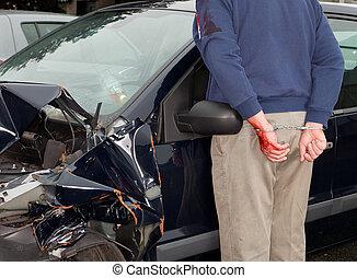 Arrested after car crash - Drunken driver being arrested...