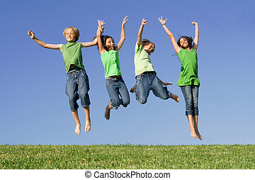 group of kids jumping after winning
