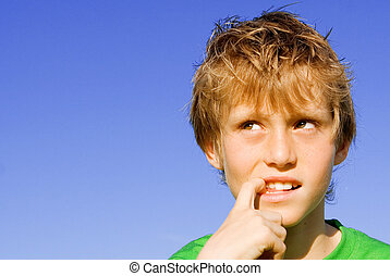 curious, puzzled shy or scared kid or child finger in mouth