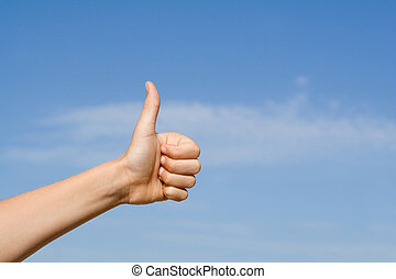 hand with thumbs up for success or winning
