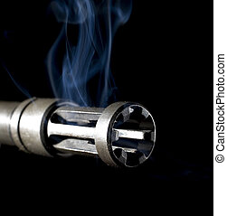 muzzle blast - smoking flash hider that is on an assault...