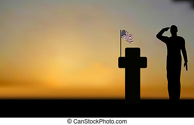 Silhouette of an army soldier saluting on hills against sunset and a grave